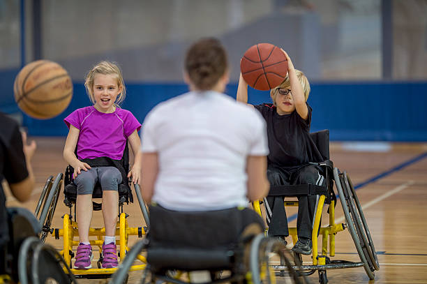 handicap people dribbling a basketball - wheelchair sports stock photos and pictures