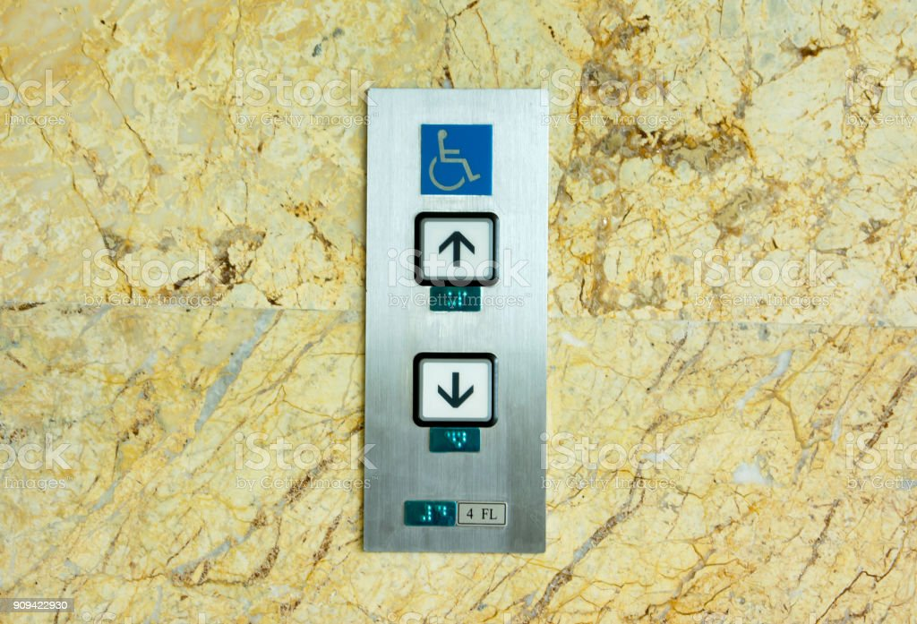 Handicap sign on elevator button with marble background stock photo