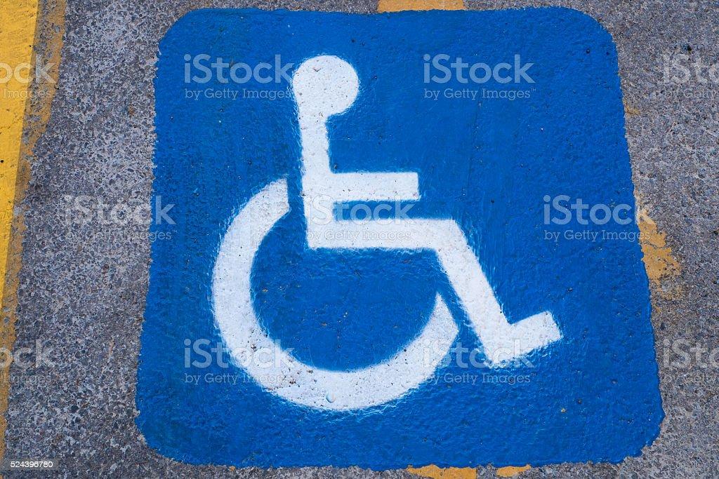handicap sign on pavement stock photo