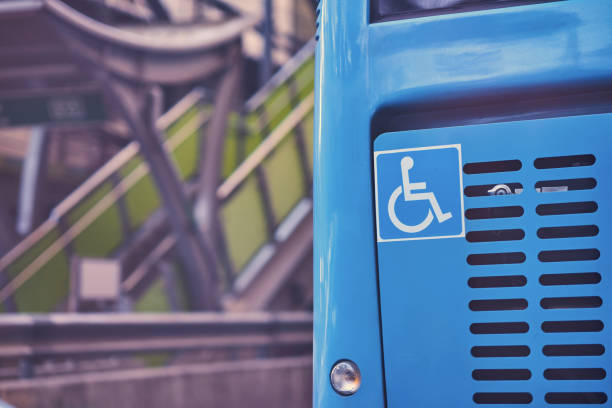 handicap sign or symbol on rear bus that for right humanity - back to school стоковые фото и изображения