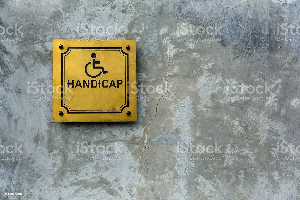 handicap symbol on cement background stock photo