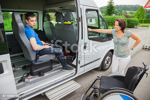 istock Handicapped boy is picked up by school bus 511059238
