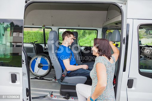 466456685 istock photo Handicapped boy is picked up by school bus 511059606