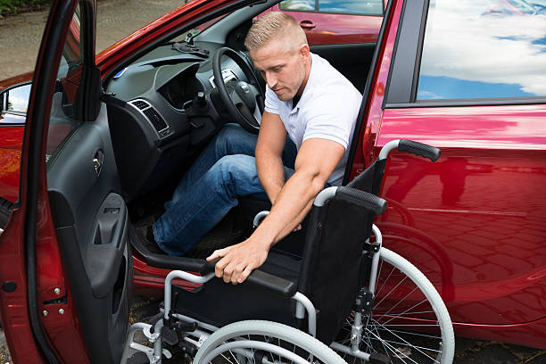 handicapped car driver with a wheelchair - impaired driving stock photos and pictures