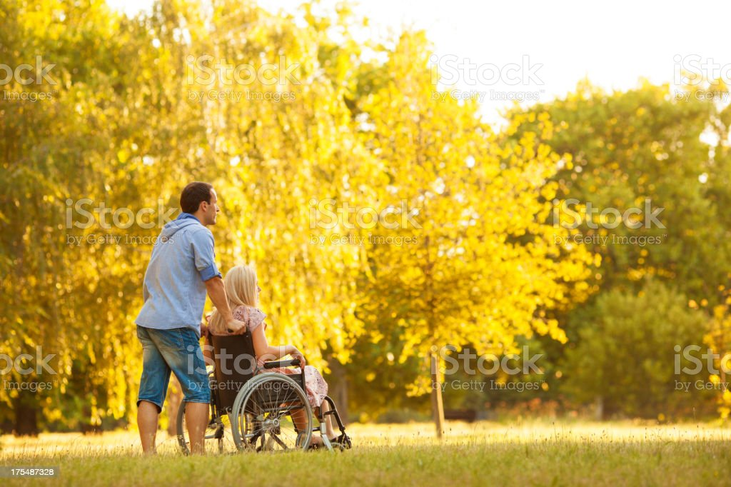 Handicapped Couple Outdoors. stock photo