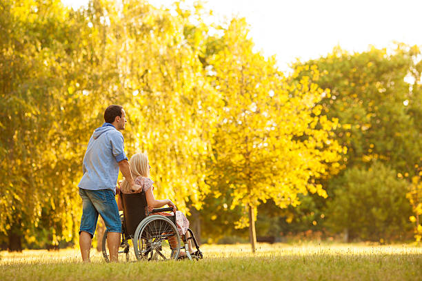 handicapped couple outdoors. - long stock pictures, royalty-free photos & images