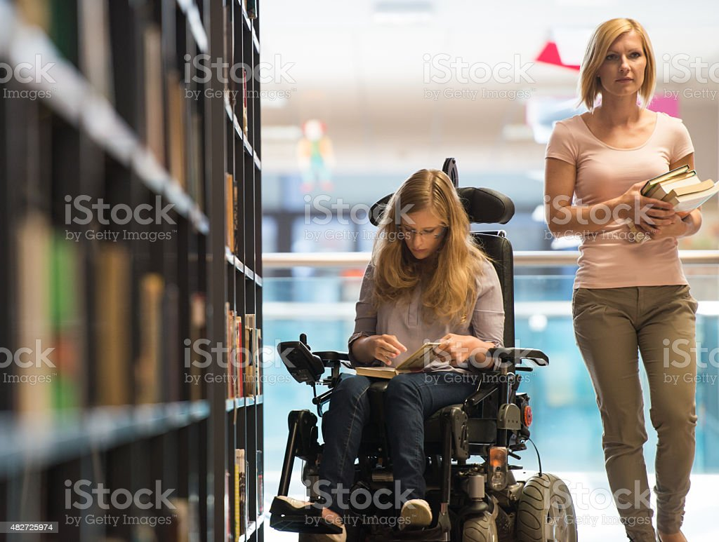 Handicapped Girl In Library stock photo