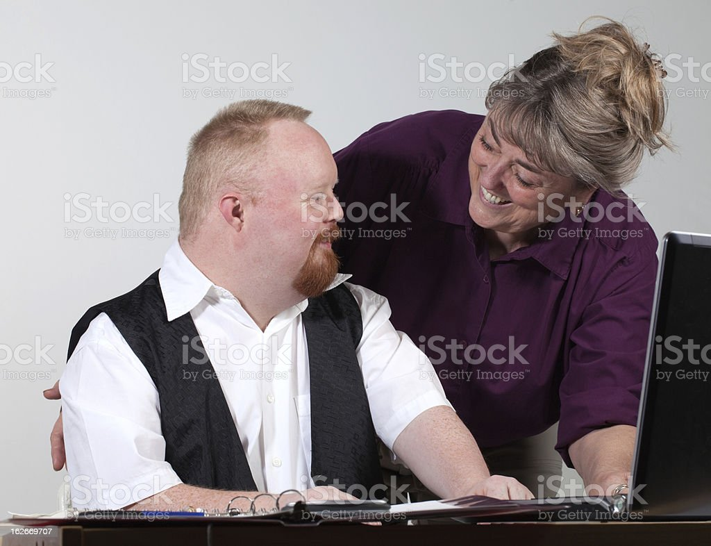 handicapped man and babyboomer at work stock photo