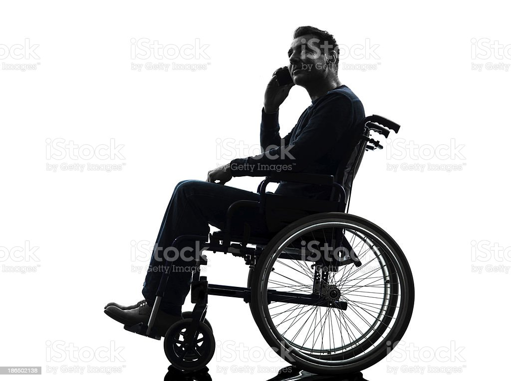 handicapped man on the telephone in wheelchair silhouette royalty-free stock photo