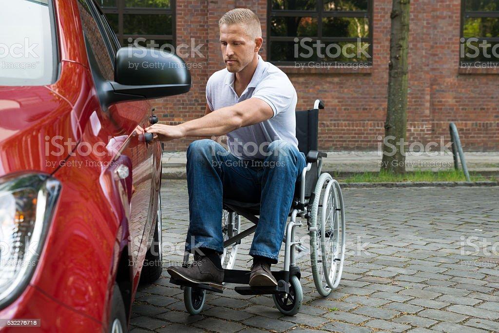 Handicapped Man Opening Door Of A Car stock photo