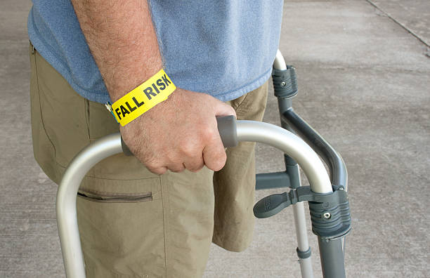 handicapped man wearing a fall risk bracelet - inpatient stock pictures, royalty-free photos & images