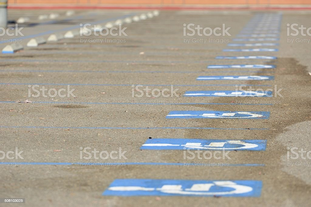 Handicapped parking lot with signs stock photo