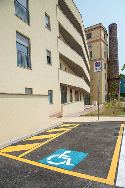 handicapped parking space in new building stock photo