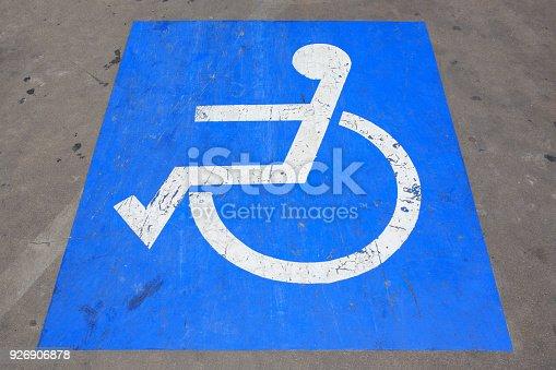 666724598istockphoto Handicapped parking spot - transportation infrastructure road markings. 926906878