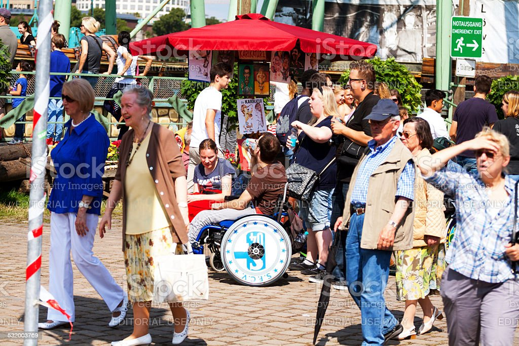 Handicapped people on summer fun fair stock photo
