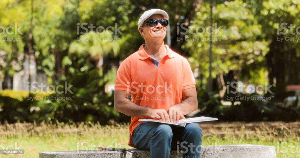 Handicapped People With Disability Blind Man Reading Braille Book'n stock photo