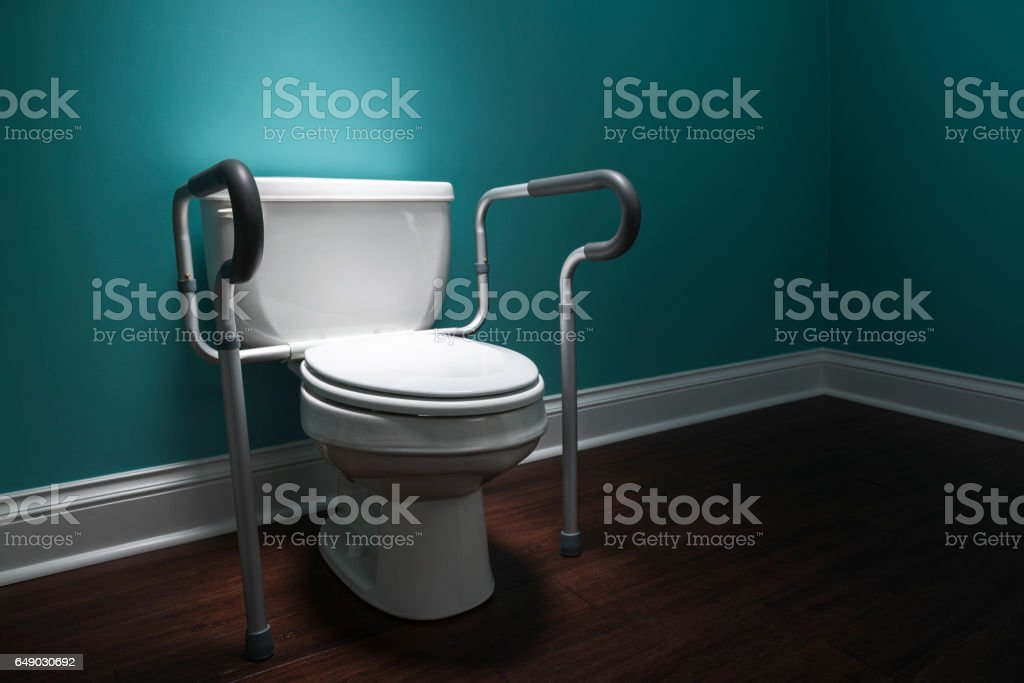 Handicapped Toilet In Spot Light With Safety Bars Stock Photo & More ...