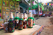 Pingla, West Bengal, India - November 16, 2014: Colourful handicrafts are being prepared for sale in Pingla village. Handicrafts are popular rural Industry in West Bengal.