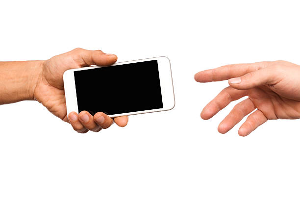 Handing a Smart Phone Handing a Smart Phone Isolated on white borrowing stock pictures, royalty-free photos & images