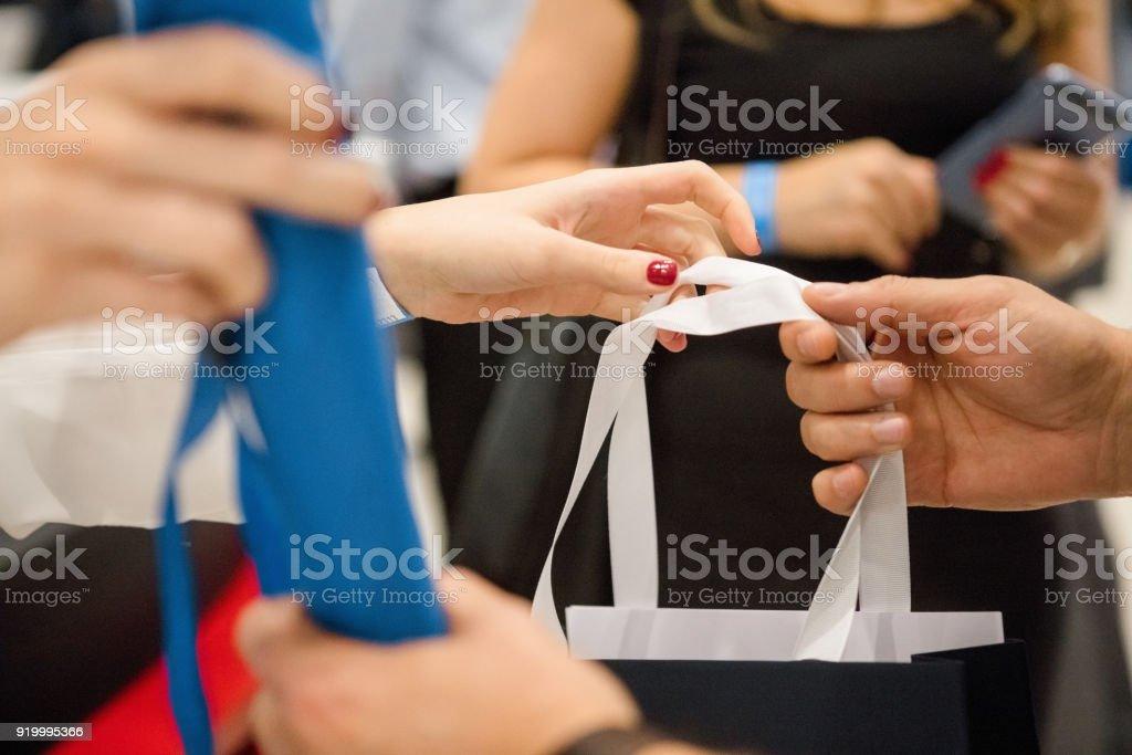 Handing goodie bags stock photo