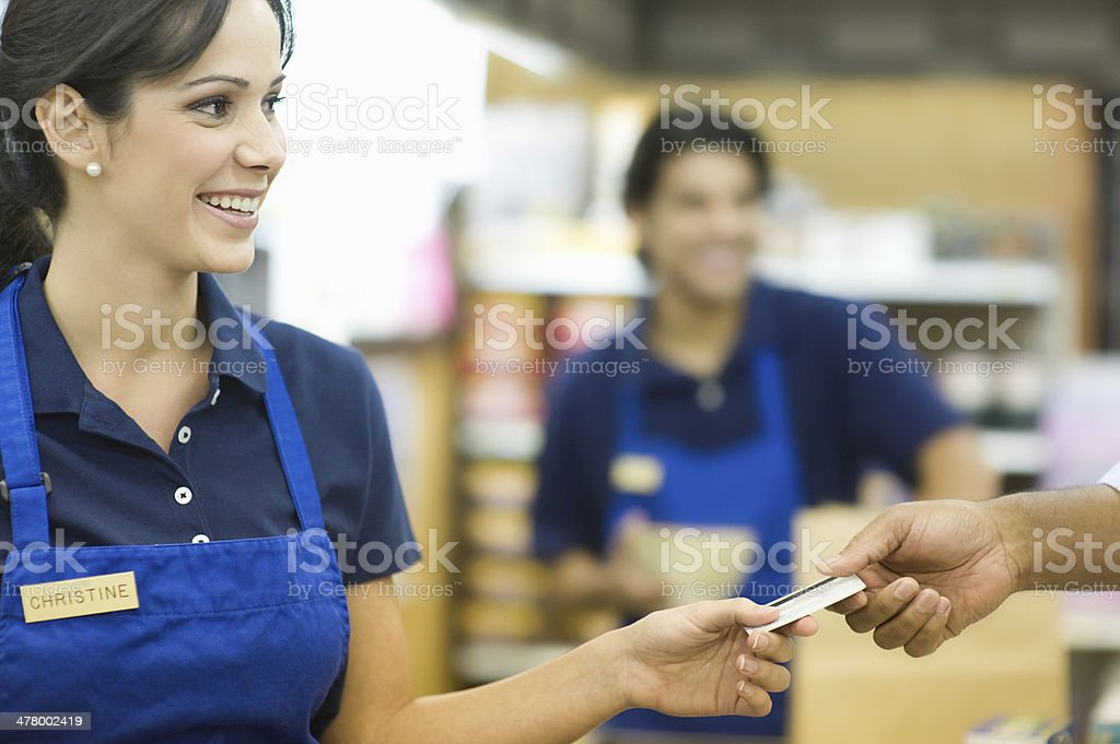 Handing Loyalty Card In Supermarket royalty-free stock photo