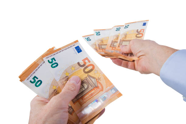 Handing out fifties european union currency bills stock photo