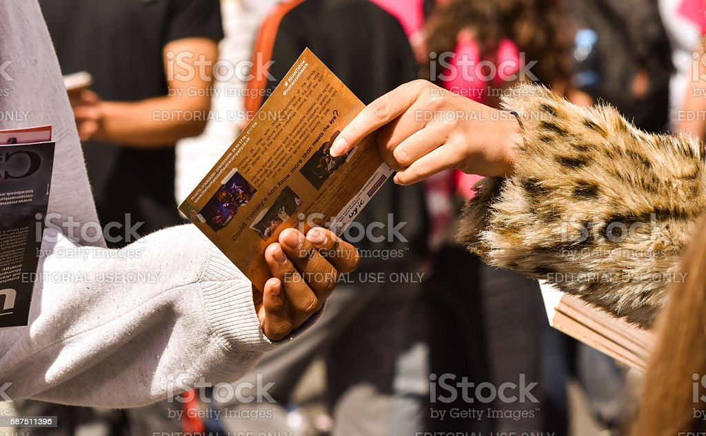 Handing out flyers at the Edinburgh Fringe. stock photo