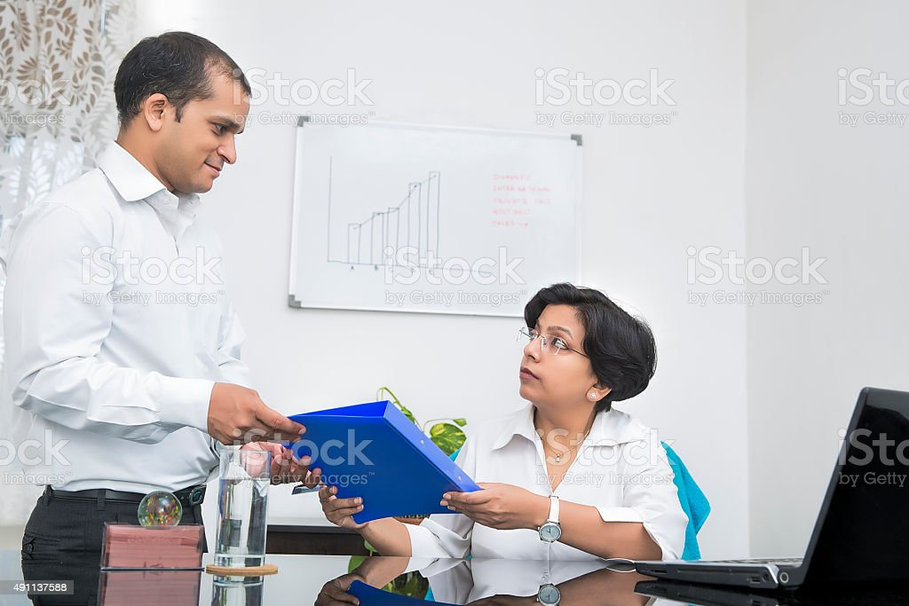 Handing over a file stock photo