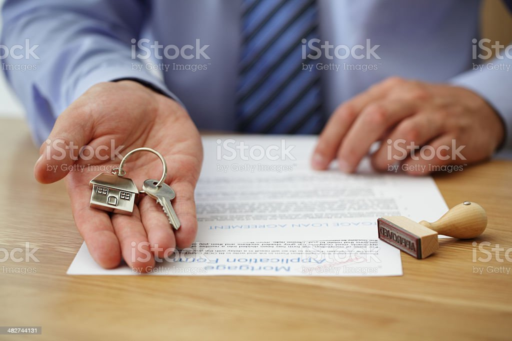 Handing over house keys stock photo