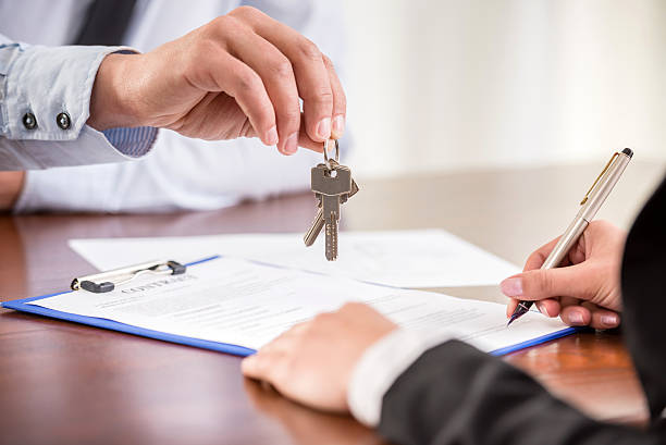 Handing over keys when signing contract stock photo