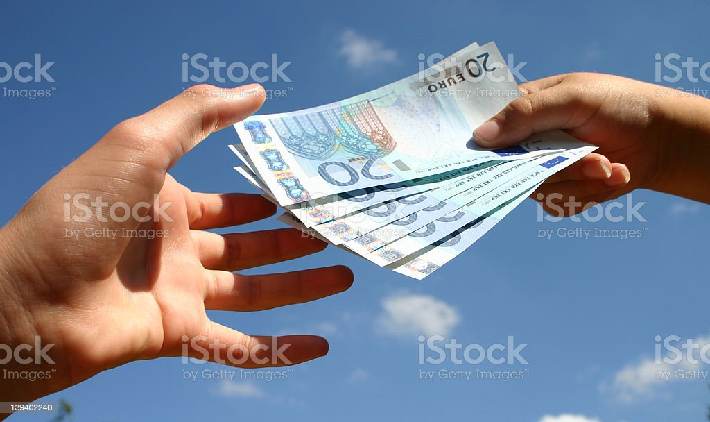 Handing over the cash royalty-free stock photo