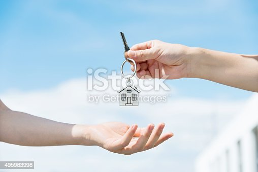 Handing over the house keys from one person to another.