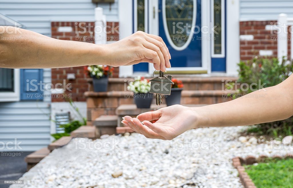 Handing Over the Key from a New Home royalty-free stock photo