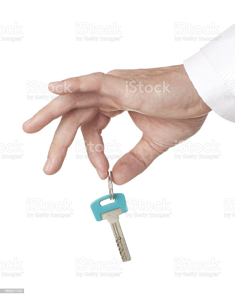 Handing over the key. royalty-free stock photo