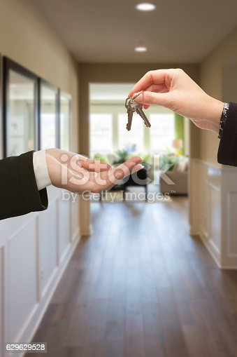 istock Handing Over The Keys Inside House 629629528