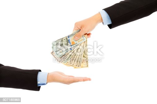 istock Handing Over us dollar Cash to Other Hand 507185965