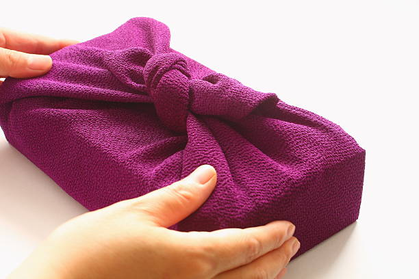 Handing wrapping cloth Furoshiki parcel, Japanese hospitality stock photo