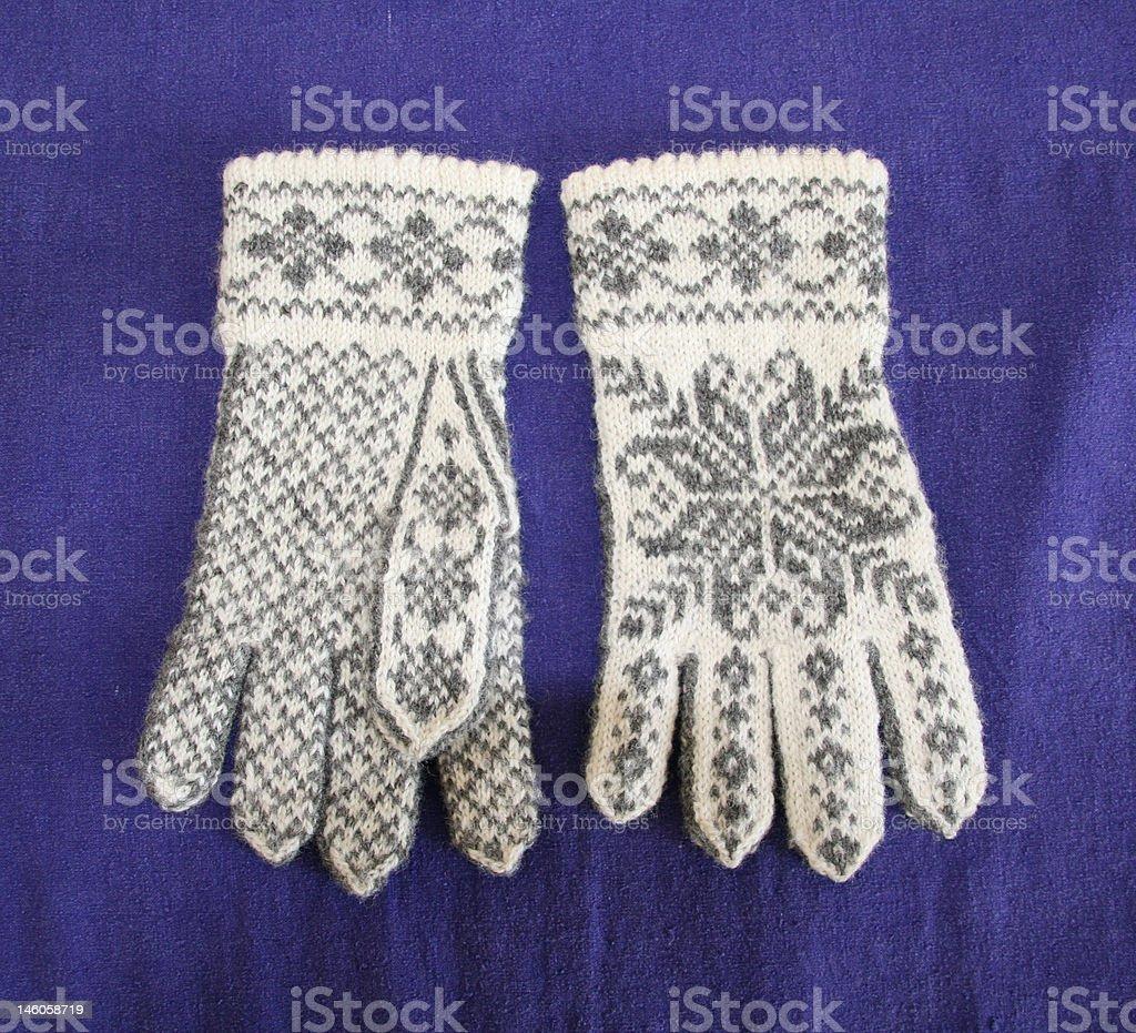 Hand-knittet woollen gloves stock photo