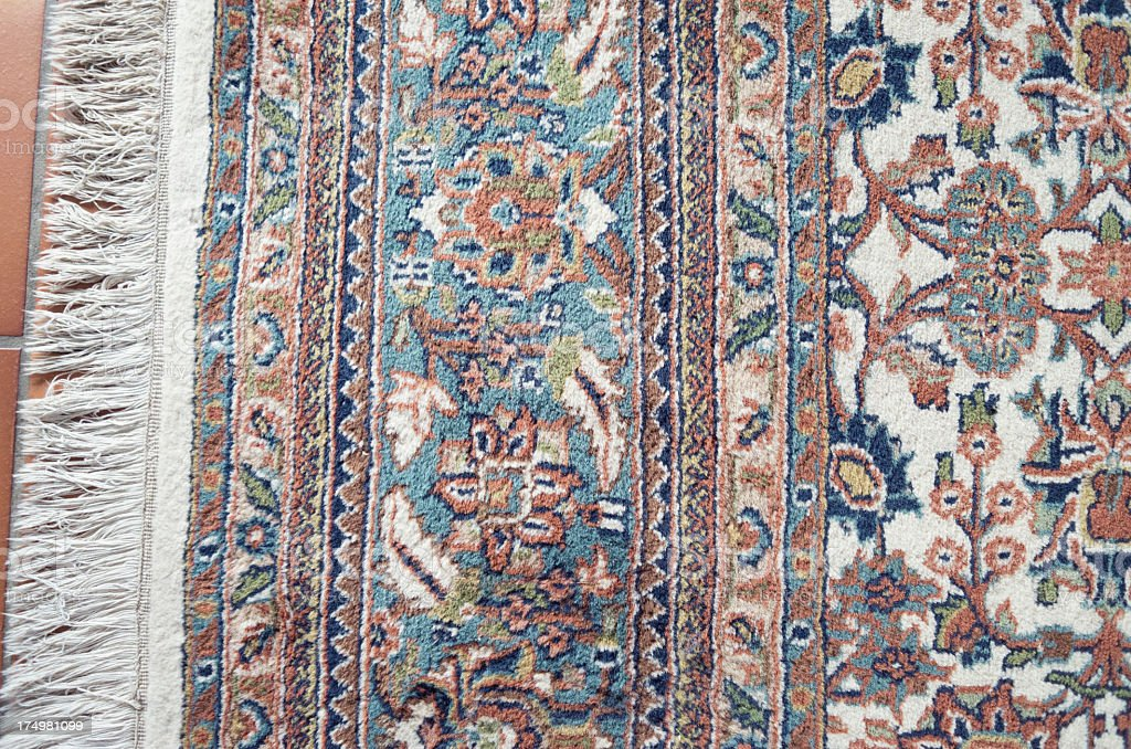 Detail of a hand knotted wool Indian carpet with Persian motif and...