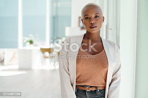 Portrait of an attractive young businesswoman standing inside her office