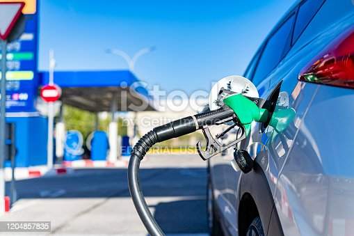 Valencia, Spain. 06 February, 2020. Handle fuel nozzle refueling vehicle at self service gas station. Predominant color is blue. High resolution 42Mp studio digital capture taken with SONY A7rII and Zeiss Batis 40mm F2.0 CF lens