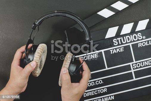istock Handle headphone on a slate black background 610579168