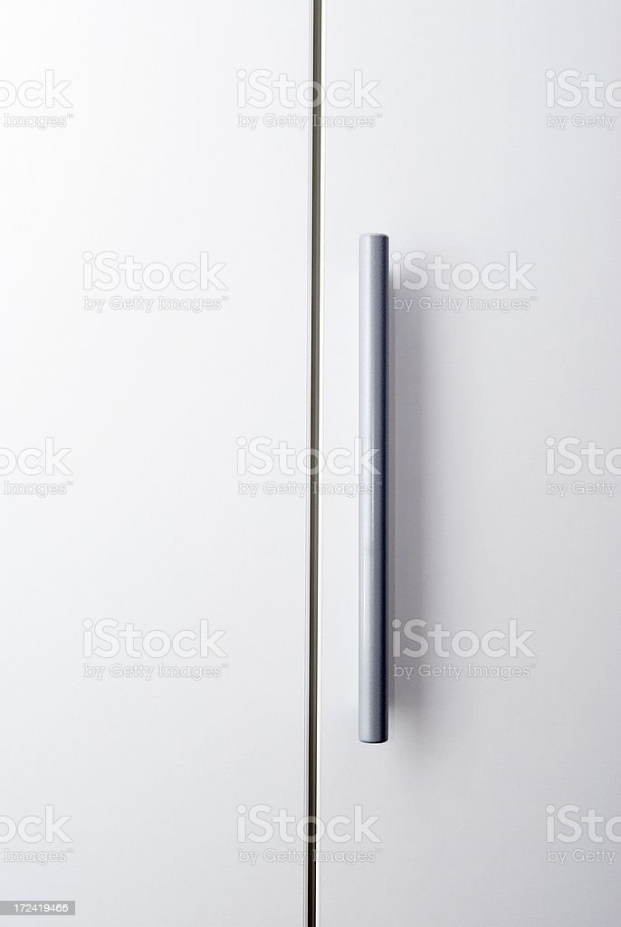 Handle on a wardrobe royalty-free stock photo