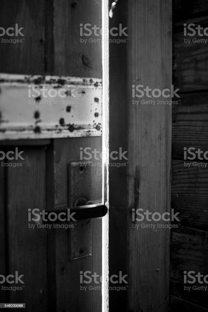 Handle on the old wooden door stock photo