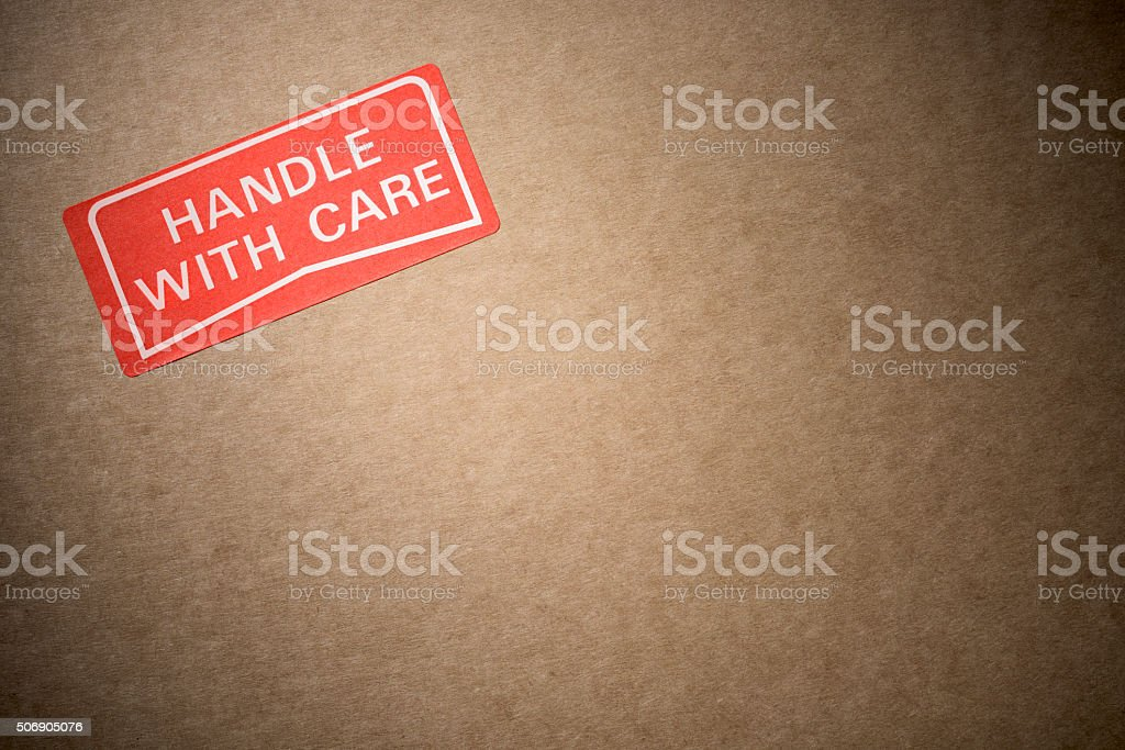Handle with care label on a brown cardboard box stock photo