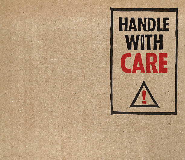 """handle with care"" on brown cardboard - fragile stock pictures, royalty-free photos & images"