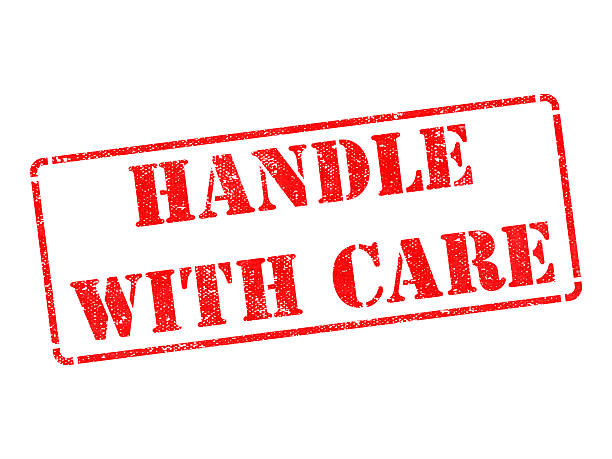 handle with care -  red rubber stamp. - fragile stock pictures, royalty-free photos & images