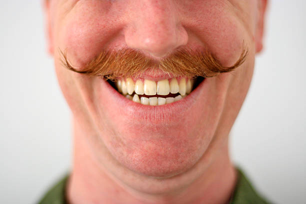 Handlebar Mustache Man A man and his red handlebar mustache. mustache stock pictures, royalty-free photos & images