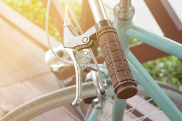 handlebar of a bicycle on natural bokeh background. travel and exercise concept - hand grip stock photos and pictures