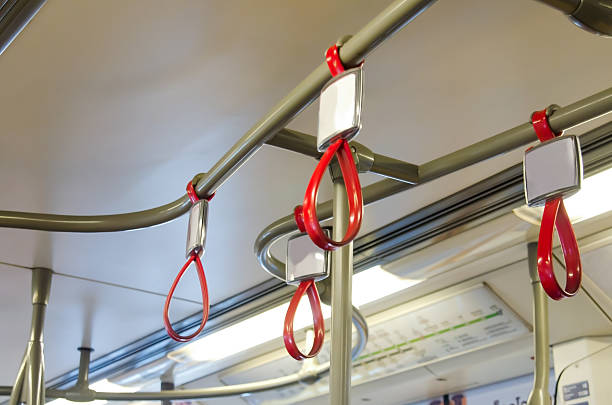handles in electric train - hand grip stock photos and pictures